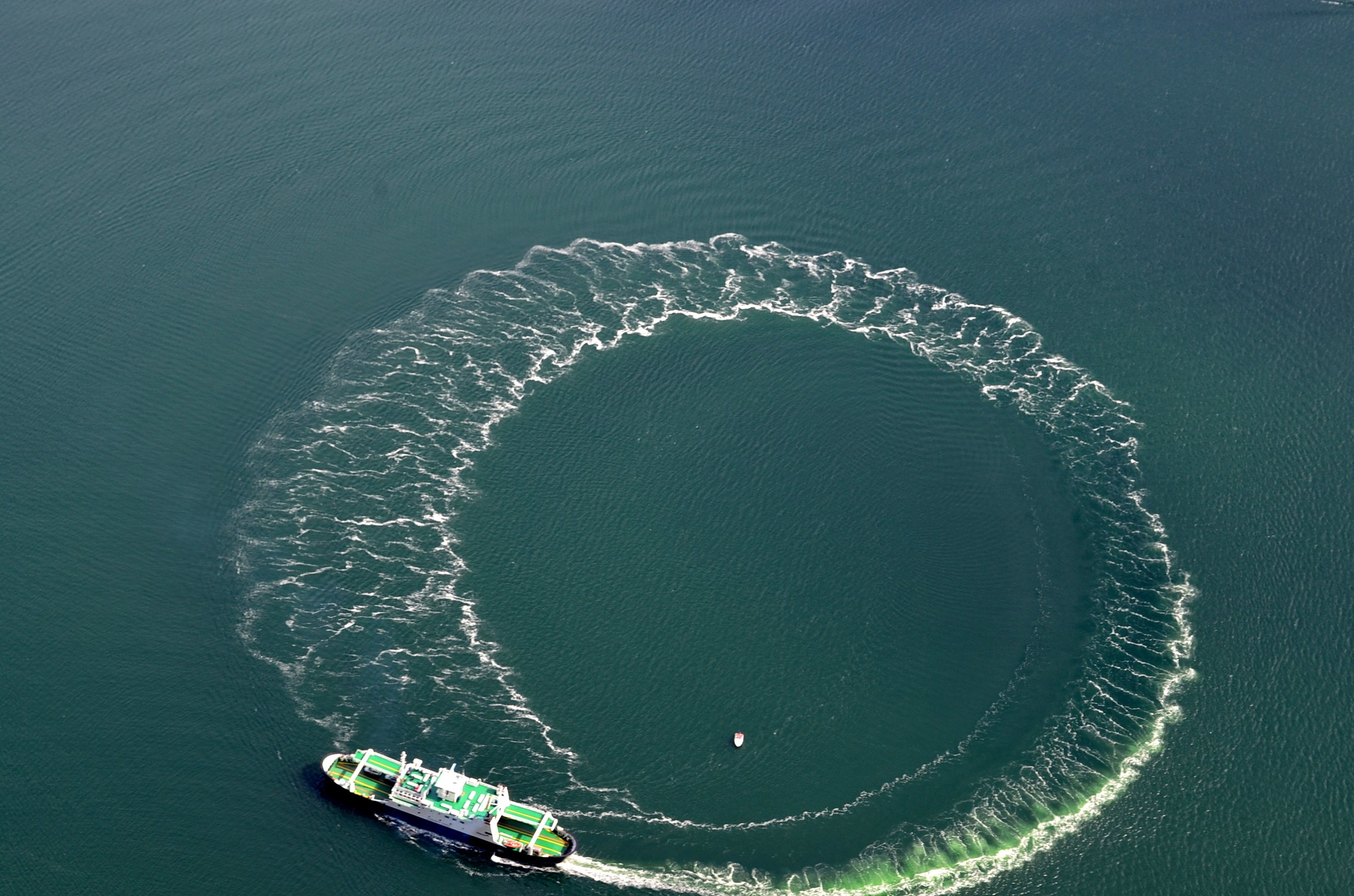 Cruise Ship doing a full 360 Preikestolen ( Pulpit rock)